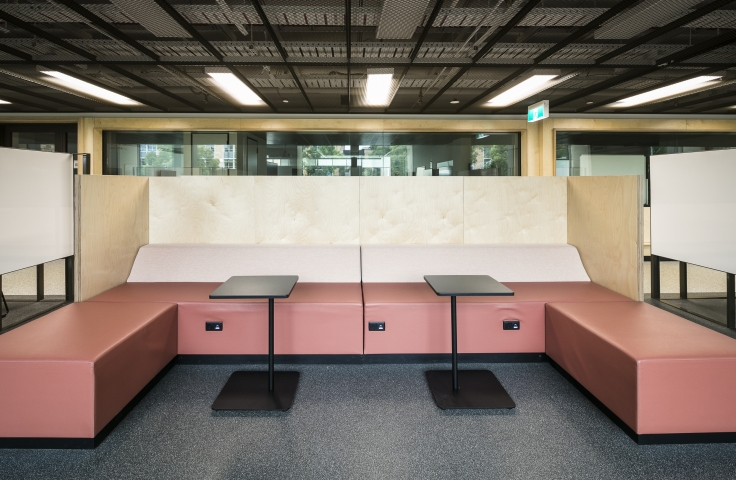 UNSW Electrical Engineering student study spaces with pink lounge and black tables