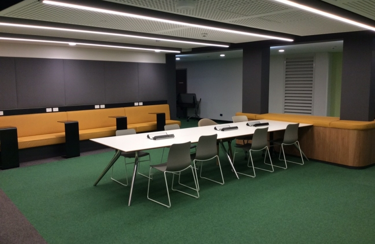 UNSW Goldstein Hall student study spaces with orange couches and white tables
