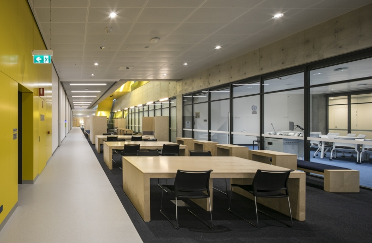 UNSW Science and Engineering Building student study spaces with yellow walls and timber tables